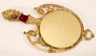 Зеркало в бронзовой оправе